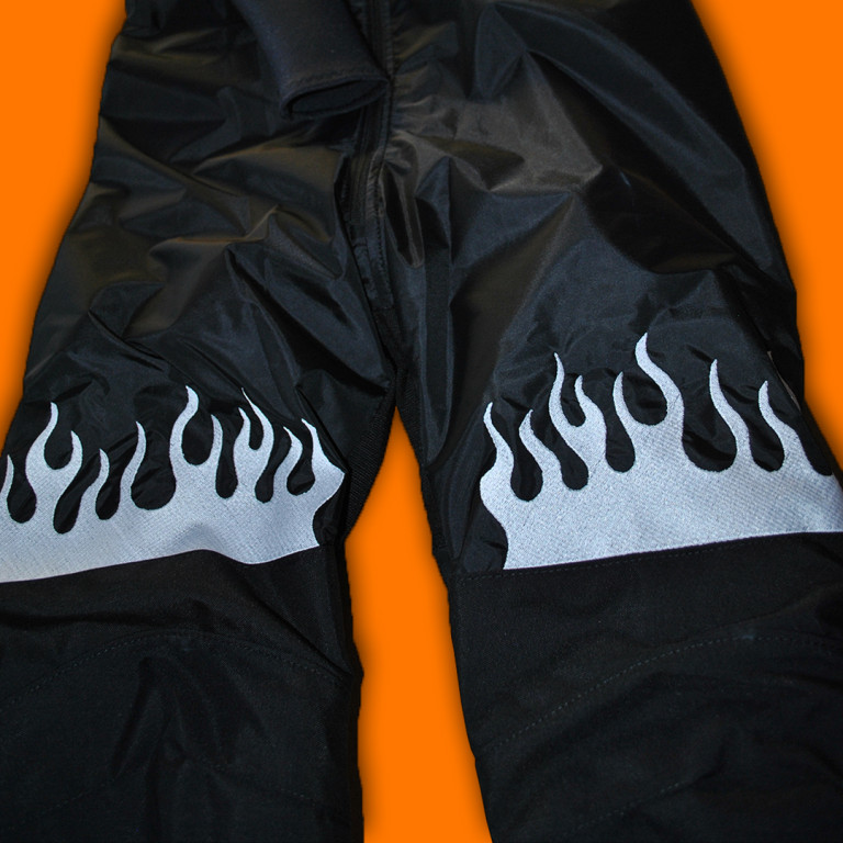 Embroidered flames in the leg area
